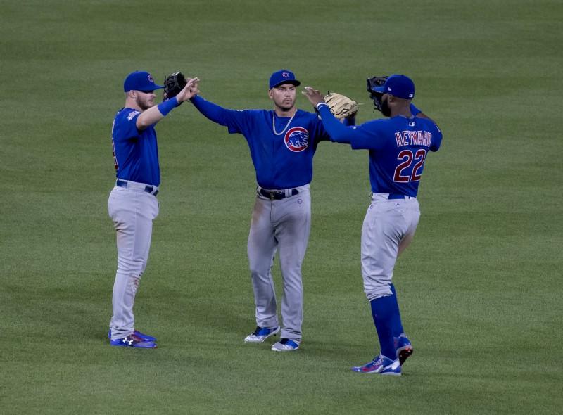 Photo of Ian Happ versus Albert Almora: The Cubs' Center Field Conundrum
